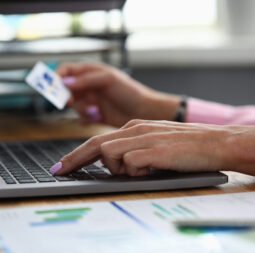 Hands hold credit card and enter info into laptop. Deposit and accumulation on card. Order goods and services online with ability to pay by credit card. Credit limit for online purchases